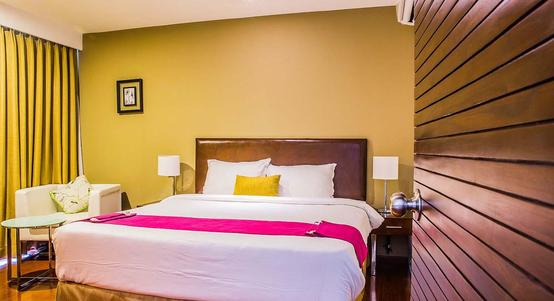 Hibiscus Suite Bedroom, Palm Exotica
